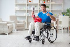 The disabled boxer at wheelchair recovering from injury Royalty Free Stock Photos