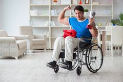 The disabled boxer at wheelchair recovering from injury Royalty Free Stock Photography