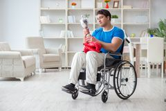 The disabled boxer at wheelchair recovering from injury Stock Images