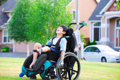 Disabled boy enjoying time at the park Stock Photo