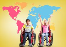 Disabled boy and girl in wheelchairs in front of colorful world map stock photo