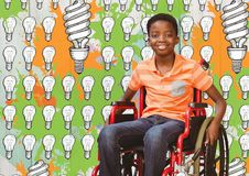 Free Disabled Boy In Wheelchair With Light Bulbs And Paint Drawings Stock Photo - 97941640