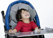 Disabled boy in medical stroller Royalty Free Stock Photos
