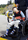 Disabled boy on school bus wheelchair lift Stock Photography