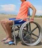 Disabled boy on a special wheelchair stock image