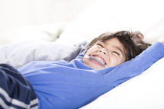 Disabled boy stretching happily Stock Photo