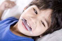 Disabled boy wearing a mouth guard Royalty Free Stock Images