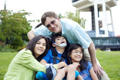 Disabled boy in wheelchair surrounded by family. Outdoors by the Space Needle in Seattle Royalty Free Stock Photos