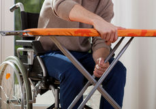 Disabled breaks down ironing board Royalty Free Stock Photos