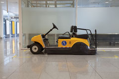 Buggy in airport. Buggy for disabled people in airport terminal Royalty Free Stock Photo