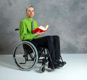 Disabled business man in wheelchair with book Stock Photography