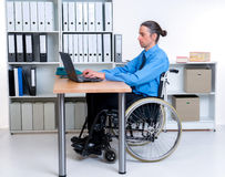Disabled business man in wheelchair working with computer Royalty Free Stock Photos
