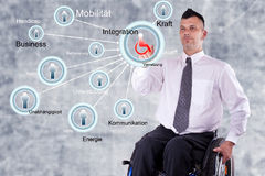 Disabled Business man in wheelchair Stock Photo