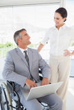 Disabled business man working with partner Royalty Free Stock Photo