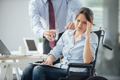 Disabled business woman with headache Royalty Free Stock Image