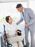 Disabled business woman working with partner Stock Images