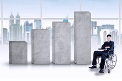 Disabled businessman with business chart Royalty Free Stock Photos