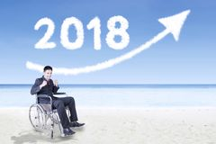 Disabled businessman with numbers 2018 Stock Image