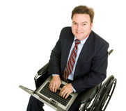 Disabled Businessman on Computer Stock Photo