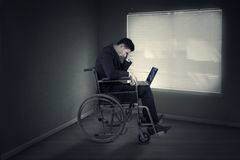 Disabled businessman expressing frustration in the office Royalty Free Stock Image