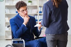 The disabled businessman having discussion with female colleague. Disabled businessman having discussion with female colleague Royalty Free Stock Photo