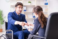 The disabled businessman having discussion with female colleague. Disabled businessman having discussion with female colleague Royalty Free Stock Photos