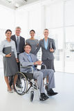Disabled businessman with his colleagues smiling at camera Royalty Free Stock Photography