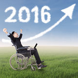Disabled businessman with numbers 2016 and arrow royalty free stock photos
