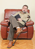 Disabled businessman reading Stock Image