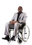Disabled businessman sitting on wheelchair Stock Images