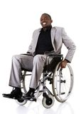 Disabled businessman sitting on wheelchair Royalty Free Stock Image