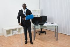 Disabled Businessman Standing In Office Stock Photos