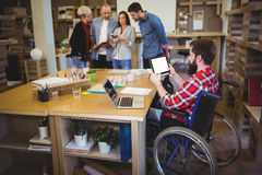 Disabled businessman using digital tablet at desk. In creative office Stock Photography