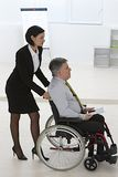Disabled businessman in a wheelchair Stock Image