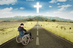 Disabled businessman in wheelchair on the road Royalty Free Stock Photo