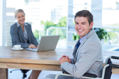 Disabled businessman working with partner Royalty Free Stock Image