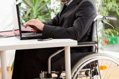 Disabled businessman working Stock Photos