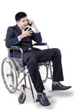 Disabled businessperson looks angry on the phone Royalty Free Stock Photos