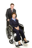 Disabled Businesswoman and Colleague Royalty Free Stock Photography