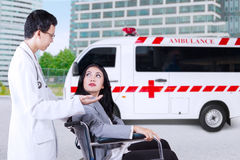 Disabled businesswoman consulting with doctor Royalty Free Stock Photos