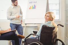 Disabled businesswoman on wheelchair holding digital tablet Royalty Free Stock Images