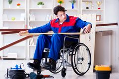 The disabled carpenter taking measurement in workshop Stock Photography