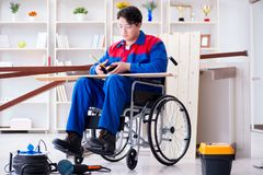 The disabled carpenter taking measurement in workshop Royalty Free Stock Photography