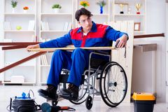 The disabled carpenter taking measurement in workshop Stock Photo