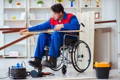 The disabled carpenter taking measurement in workshop Stock Image