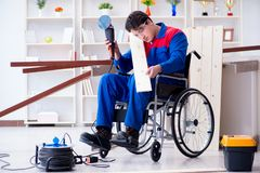 The disabled carpenter working with tools in workshop Royalty Free Stock Image