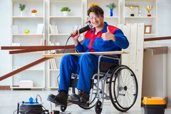 The disabled carpenter working with tools in workshop. Disabled carpenter working with tools in workshop Stock Images