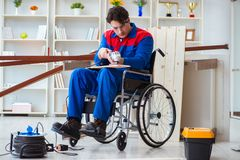 The disabled carpenter working with tools in workshop Stock Photography
