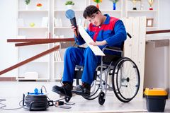 The disabled carpenter working with tools in workshop Stock Images
