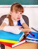 Disabled child with broken arm. Royalty Free Stock Images